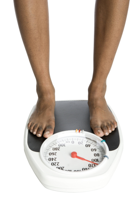 woman standing on a scale