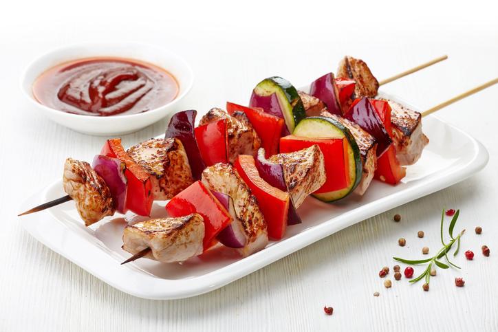 grilled pork fillet and vegetables on white background, pork barbecue