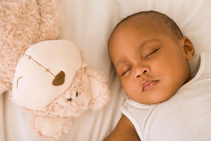 African American baby sleeping on back
