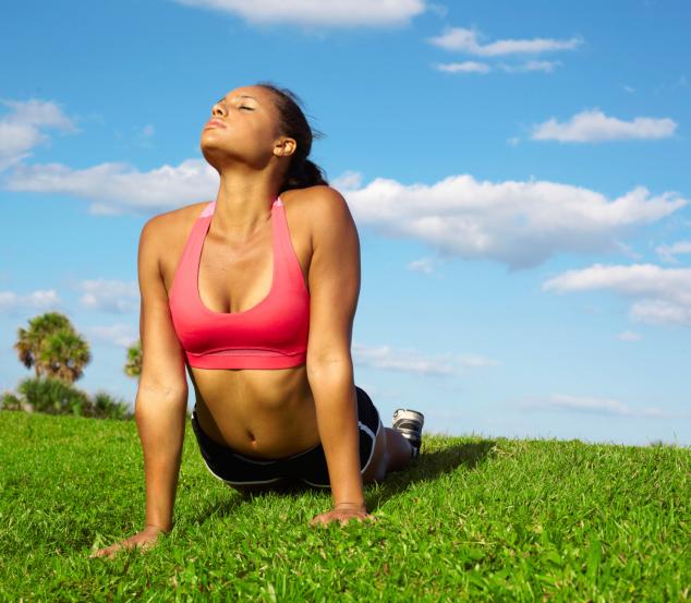 Young Beautiful Mixed Race Woman Doing Yoga Upward Dog
