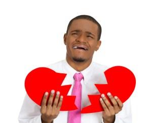 african american man holding broken heart
