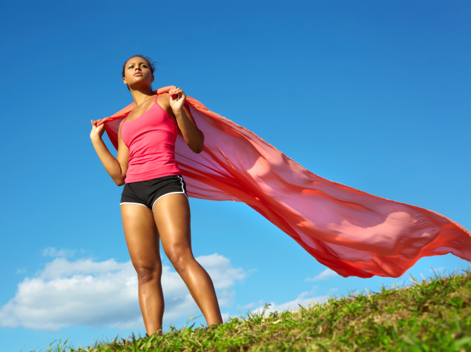 woman standing with scarf in wind