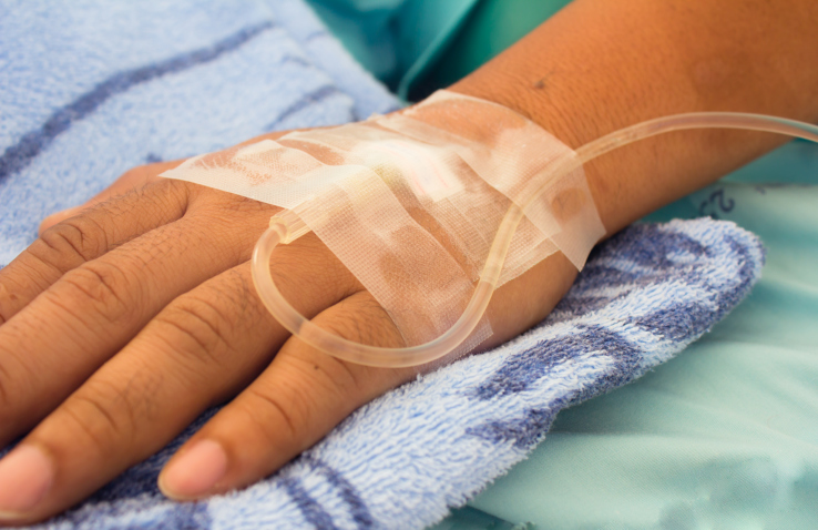 closeup shot of a patient's hand with saline intravenous (iv)