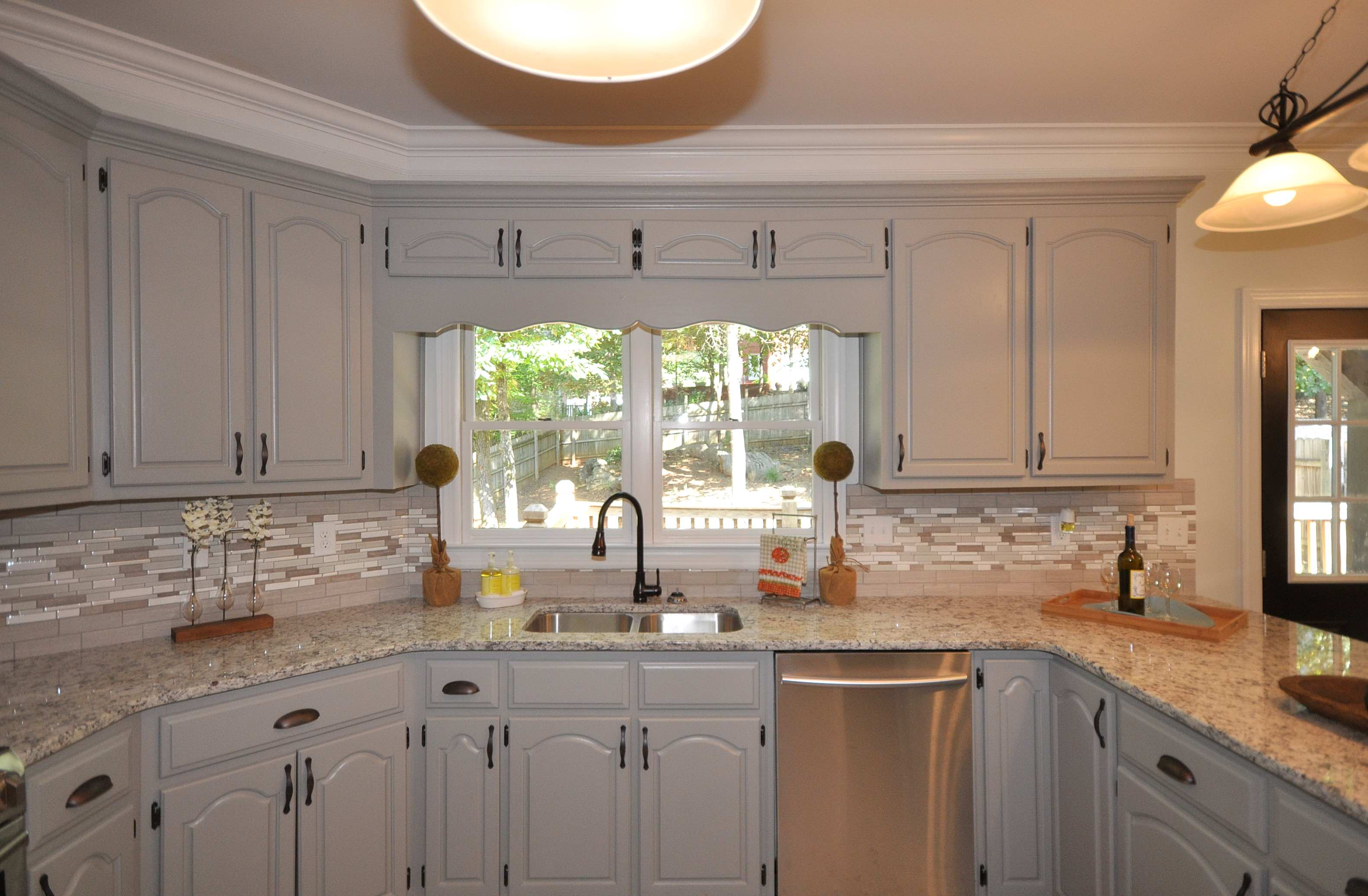 paintedcabinets kitchen cabinet updates Updates include Painting the kitchen cabinets Hazy Stratus by Valspar these cabinets were in great shape and there were a TON OF THEM so replacing