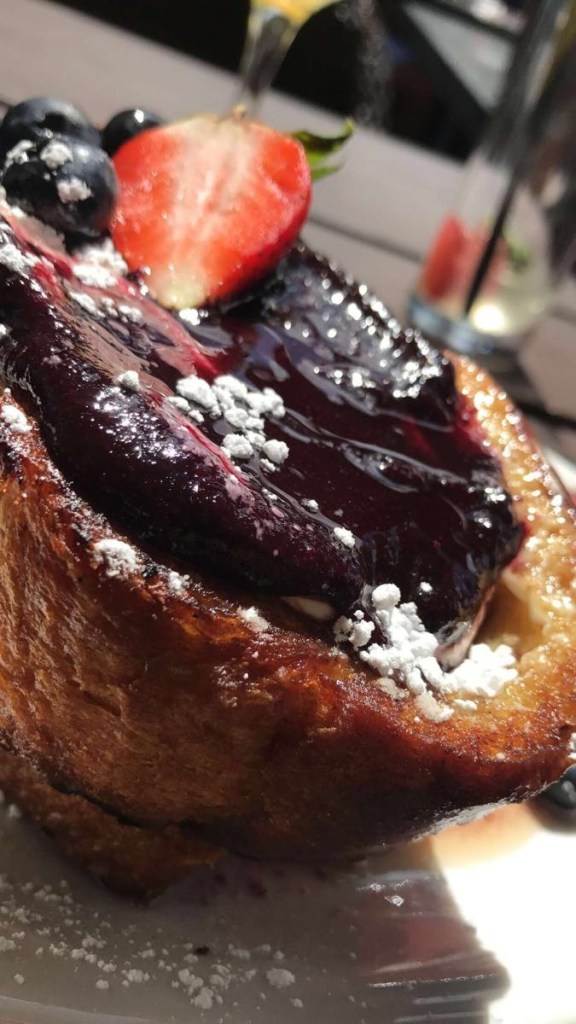 Brioche French Toast, sweat cream cheese, crushed blueberries, applewood bacon, butter maple syrup.   That bacon is AMAZING! We wanted to order a side of it, but alas no a la carte!