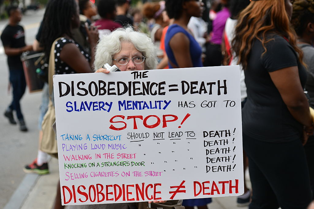 ATLANTA, GA - AUGUST 18:  View of protesters holding signs at the Atlanta #RallyforFerguson Justice For Mike Brown at the CNN Center on August 18, 2014 in Atlanta, Georgia.