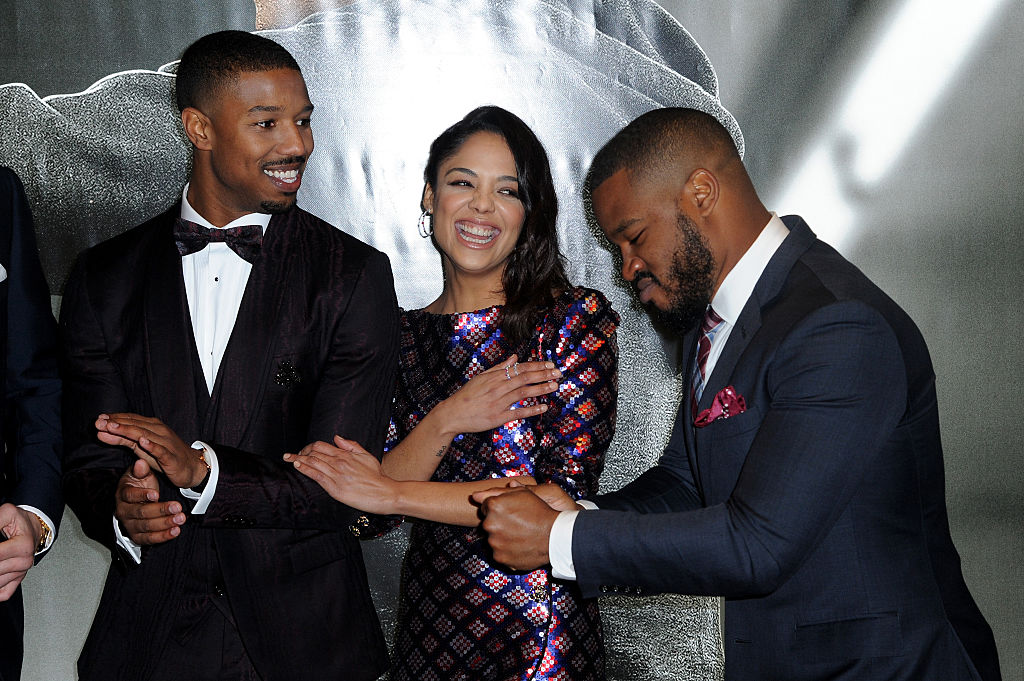 "LONDON, ENGLAND - JANUARY 12:  (L-R) Michael B. Jordan, Tessa Thompson and Ryan Coogler attend the European Premiere of ""Creed"" on January 12, 2016 in London, England."