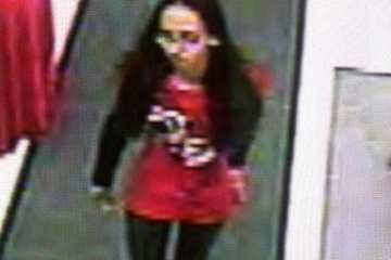 A Sears surveillance video image of the woman who allegedly met the victims at the Plaza