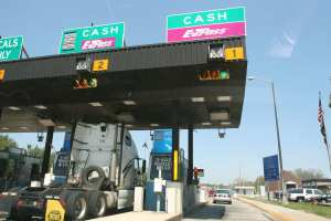 The New Jersey Turnpike Authority 's E-ZPass electronic toll collection system has reduced toll plaza delay by about 85 percent overall and decreased overall fuel consumption on the state's turnpike system by some 1.2 million gallons per year, cutting emissions of volatile organic compounds (VOCs) by 0.35 tons per day. (Tennessee Wanderer via Flickr)