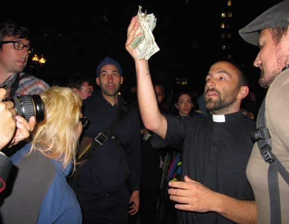 Moments after the Tuesday morning arrests, Rev. Jason Lydon collects donations for bail money. Lydon has marched with the Occupy Boston protest several times and his congregation, the Community Church of Boston, is a Unitarian Universalist church in the Back Bay vocal in its solidarity with Occupy Wall Street and similar movements across the globe. (Blast Staff photo/John Stephen Dwyer)