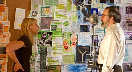 Carrie (Claire Danes) and Saul (Mandy Patinkin) consult the the rainbow board for clues about Abu Nazir.