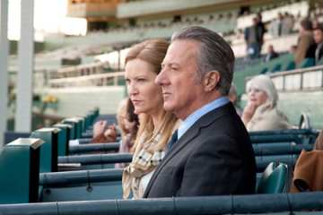 Ace Bernstein (Dustin Hoffman) watches his horse, Pint of Plain make his debut with Claire (Joan Allen).