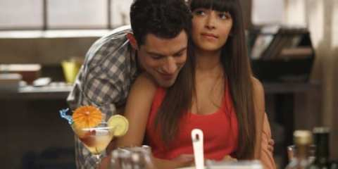Schmidt (Max Greenfield) rubs the belly of Cece (Hannah Simone) hoping she's carrying his child