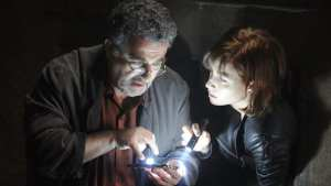 Claudia (Allison Scagliotti) and Artie (Saul Rubinek) investigate an artifact in the Warehouse 13 season premiere