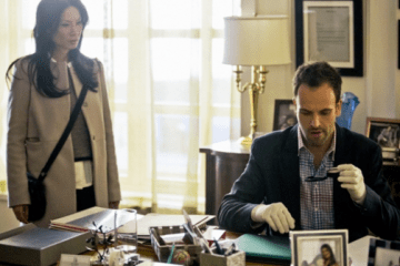 Joan (Lucy Liu) and Sherlock (Jonny Lee Miller) investigate the victims office.