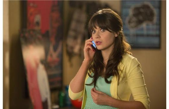 Jess (Zooey Deschanel) tries to figure out her hectic day.