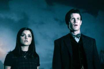 Clara (Jenna Louise-Coleman) and the Doctor (Matt Smith) look upon his tomb.