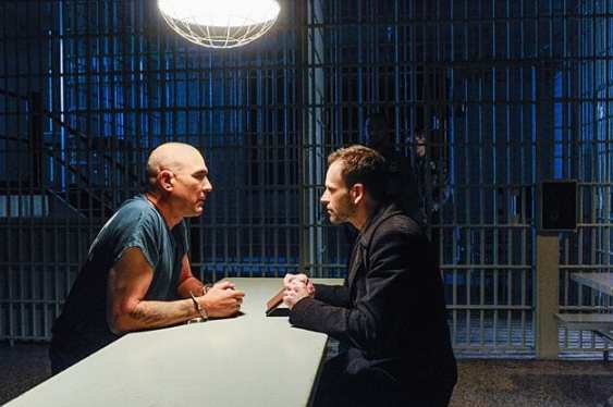 Sherlock (Jonny Lee Miller) needs information from Moran (Vinnie Jones).