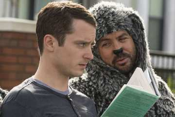Ryan (Elijah Wood) and Wilfred (Jason Gann) enjoy the dog park.