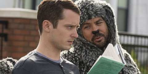 Ryan (Elijah Wood) and Wilfred (Jason Gann) enjoy the dog park.