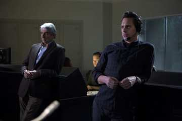 Charlie (Sam Waterston) and Don (Thomas Sadoski) watch over the broadcast.