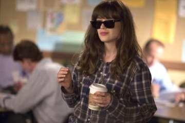 Jess (Zooey Deschanel) tries to impress her new co-workers.