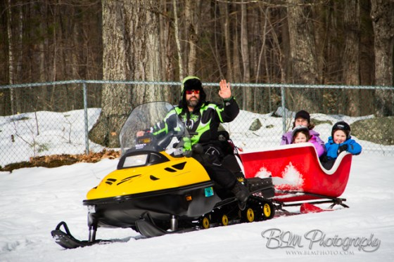 Jaimie Kierstead Giving Snowmobile Ride