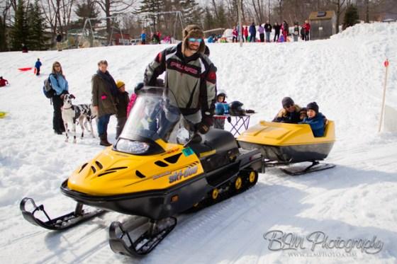 Chris Raymond giving a Snowmobile Ride