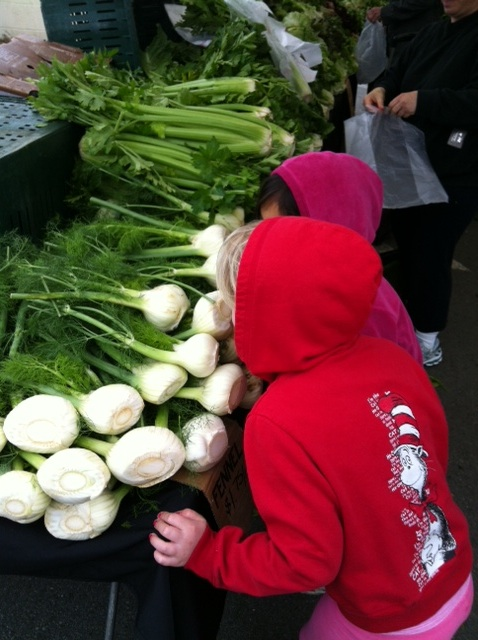 smelling foods at farmers market