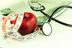 apple, tape measure, scale, stethoscope