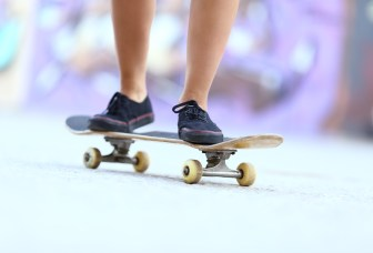 Teenager Skater Girl Legs On A Skate Board