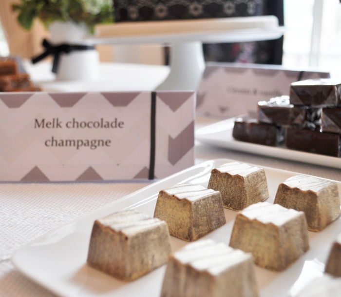 Elegant Black & White Dessert Table milk chocolate filled with champagne cream