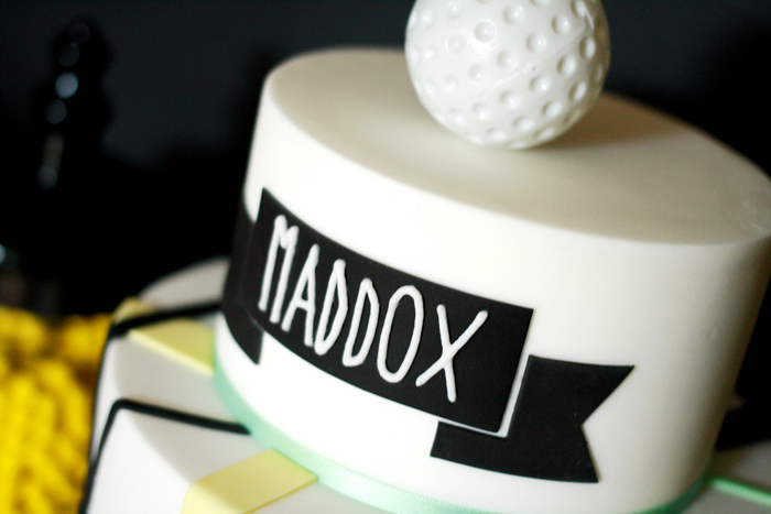 Golf cake black yellow and green