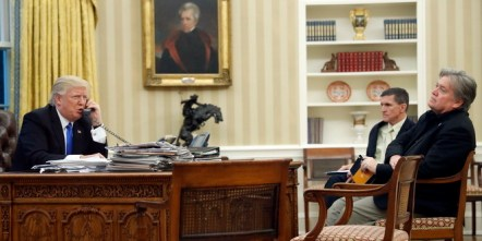 President Donald Trump speaks on the phone with Prime Minister of Australia Malcolm Turnbull, with National Security Adviser Michael Flynn, center, and chief strategist Steve Bannon, right, in the Oval Office of the White House, Saturday, Jan. 28, 2017 in Washington. (AP Photo/Alex Brandon)