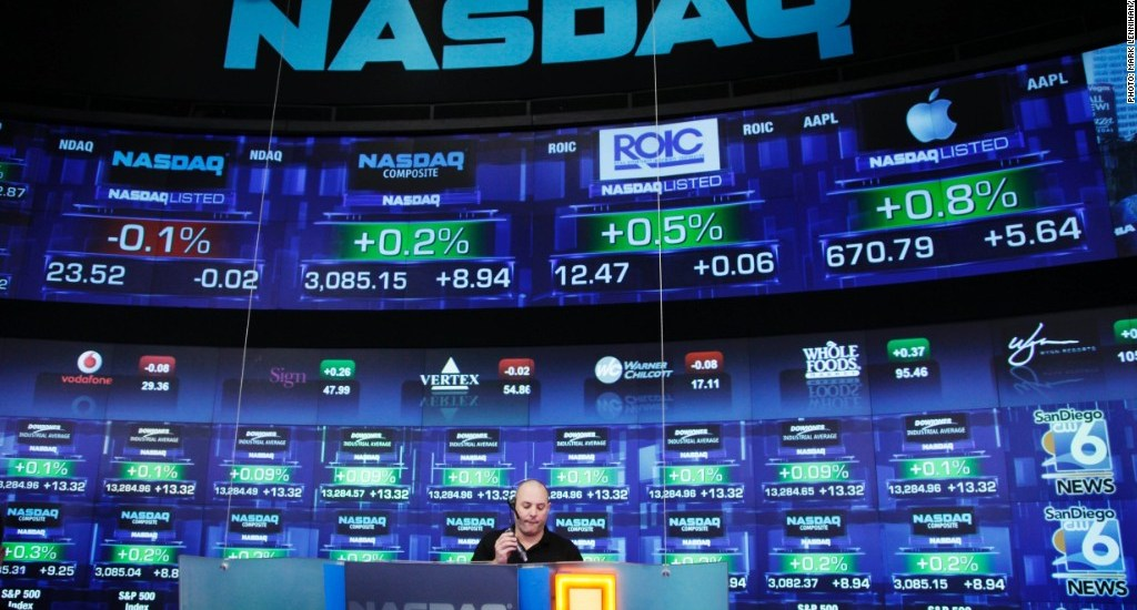 Stock prices are shown at the Nasdaq MarketSite, Tuesday, Aug. 21, 2012 in New York. (AP Photo/Mark Lennihan)