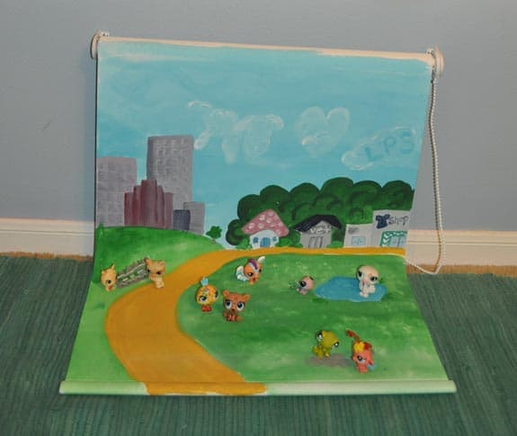 kids-playmat-that-is-wall-mounted-and-made-from-a-white-roller-blind