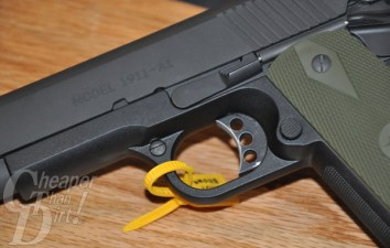 "Picture shows a close-up of a black polymer-framed 1911 stamped ""MODEL 1911-A1"""