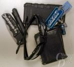 Picture shows a wallet, phone, sunglasses, a knife and two flashlights.