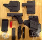 Picture shows a GLOCK 19, three holsters and a magazine pouch.