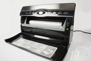 Picture shows a FoodSaver machine with the front open and a roll of plastic inside.