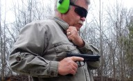 Bob Campbell shooting a pistol from the hip
