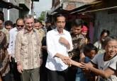 Presiden Indonesia Joko Widodo (difoto tahun silam) telah menggabungkan kementerian lingkungan hidup dan kehutanan negara tersebut, suatu langkah berani yang dapat menghasilkan imbalan dengan menyederhanakan yurisdiksi. Foto Kedutaan AS/Flickr