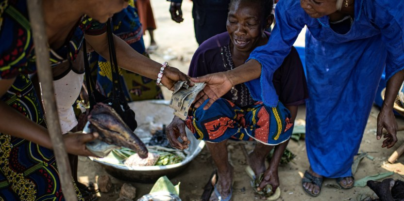Women negotiate meat prices at the Moutuka Nunene market in Lukolela, Democratic Republic of Congo.