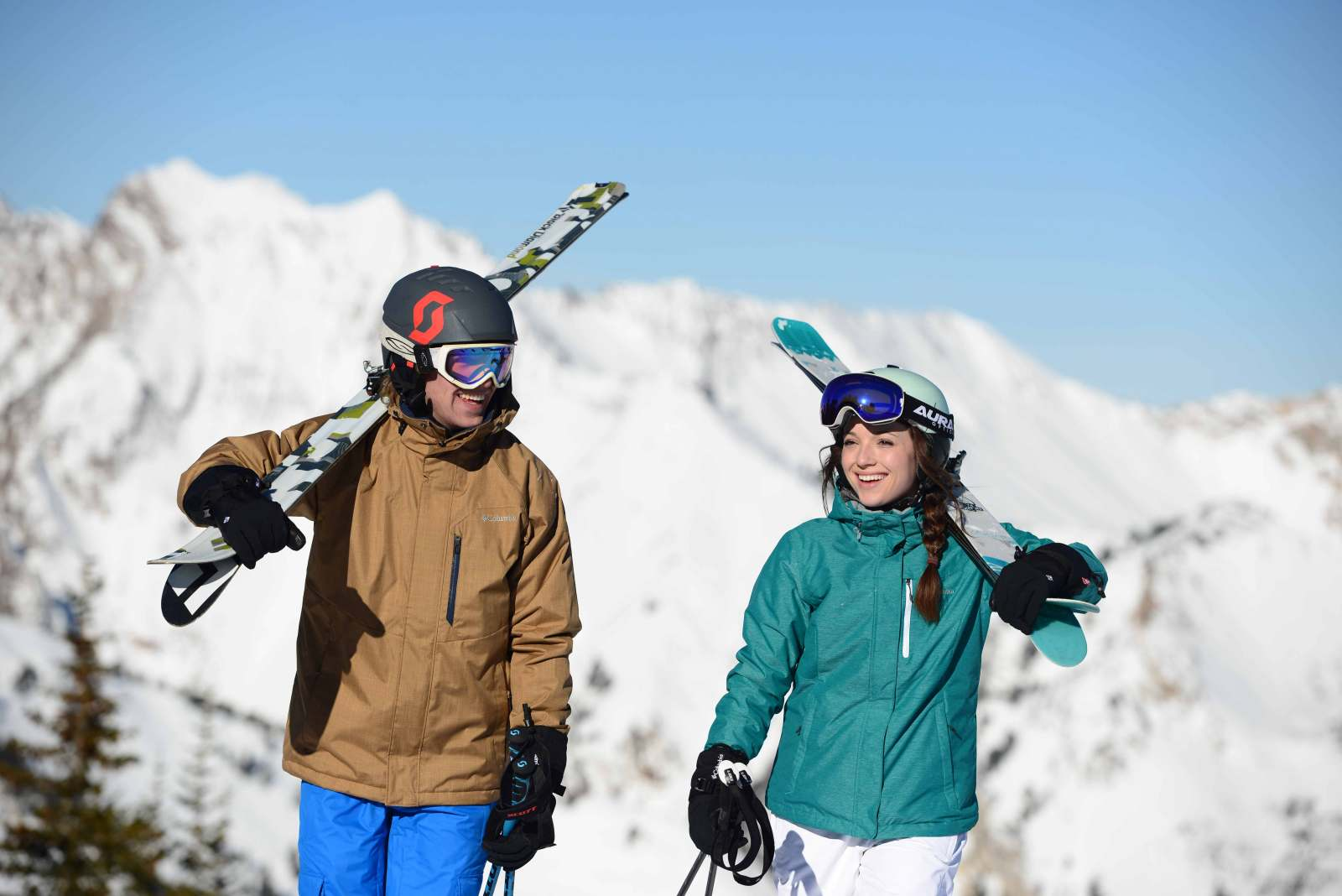 couple holding skis during winter