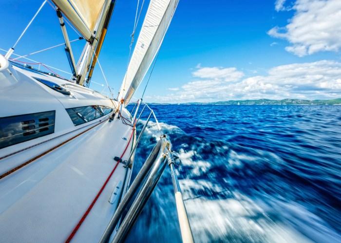 Speeding through the open sea on a sailboat