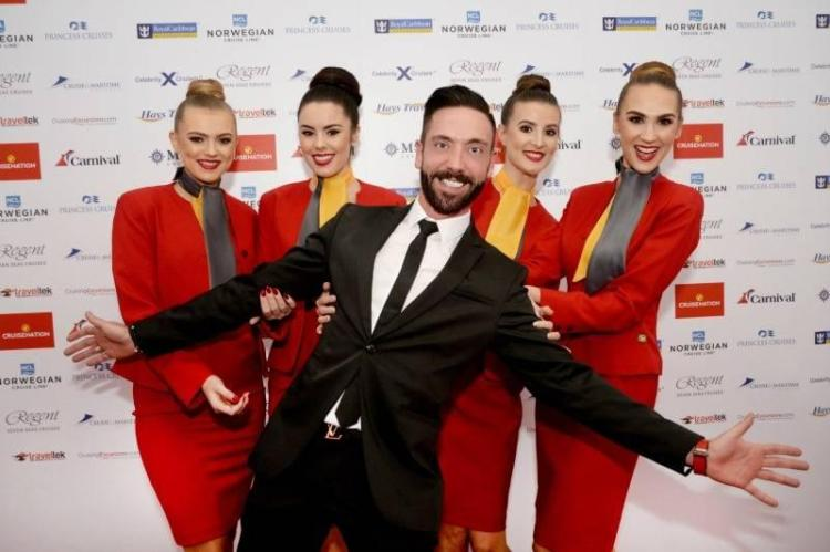 Cruise Nation founder Phil Evans with models wearing new uniform