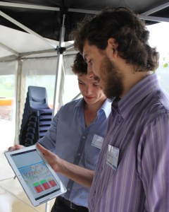 Two men looking at a tablet computer