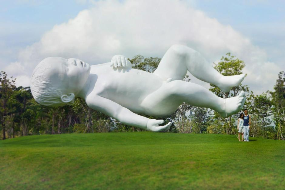 The Monumental Task Once described as a bundle of joy, this giant floating baby by Marc Quinn depicts two things - the freedom sacrificed to raise one, and that even when they are tiny, their impact is huge.
