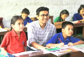 Project FUEL founder Deepak Ramola works with students in a classroom.