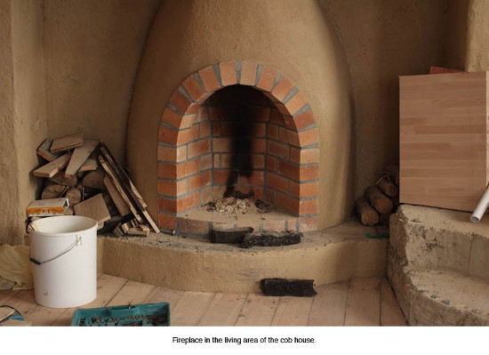 A fireplace in a cob house